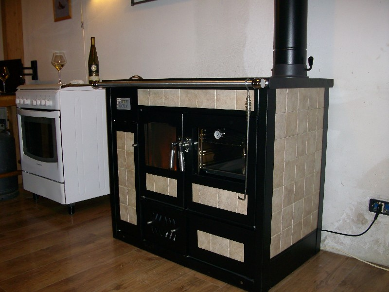 Cucine economiche a legna nordica idee di design per la casa for Cucine economiche prezzi